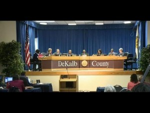 dekalb board of commissioners sitting on stage